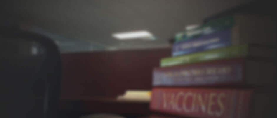 Blurred image of a pile of textbooks on vaccine injury compensation