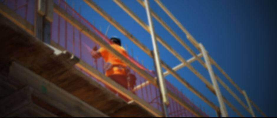 Construction worker on a scaffolding